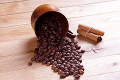 Roasted coffee. Beans on a wooden background Stock Photography