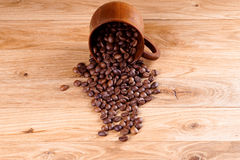 Roasted coffee. Beans on a wooden background Stock Photo