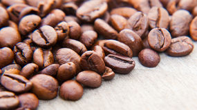 Roasted coffee beans. On wooden background Royalty Free Stock Photo