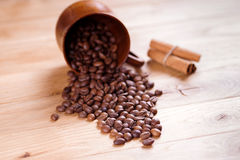 Roasted coffee. Beans on a wooden background. Shallow depth of field Royalty Free Stock Image