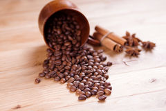 Roasted coffee. Beans on a wooden background.Shallow depth of field Stock Photos