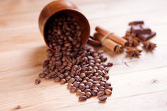 Roasted coffee beans. On a wooden background. Shallow depth of field Royalty Free Stock Photo