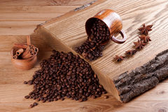 Roasted coffee beans. On a wooden board Royalty Free Stock Photo