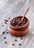 Roasted coffee beans in wooden bowl, selective focus Stock Images