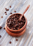Roasted coffee beans in wooden bowl, selective focus Stock Photography