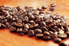Coffee roasted on wooden. Royalty Free Stock Image