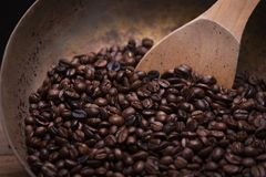 Roasted coffee beans with wooden spoon Royalty Free Stock Photography