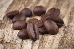 Roasted coffee beans in wooden. Spoon placed Royalty Free Stock Photo