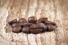 Roasted coffee beans in wooden. Spoon placed Royalty Free Stock Photography