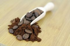 Roasted coffee beans and a wooden spoon. Stock Photos
