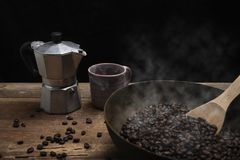 Roasted coffee beans with wooden spoon Stock Image