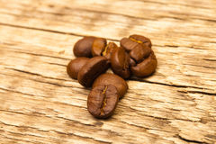 Roasted coffee beans on wooden table Royalty Free Stock Image