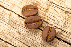 Roasted coffee beans on wooden table Stock Image