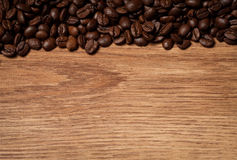 Roasted coffee beans on wooden texture Stock Images