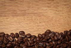 Roasted coffee beans on wooden texture Stock Image