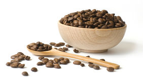 Roasted coffee beansin a wooden cup Royalty Free Stock Photography