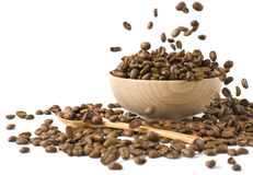 Roasted coffee beansin a wooden cup Stock Image