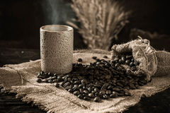 Roasted coffee been purifying from bag. In the still life style royalty free stock photo