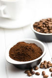 Roasted coffee in ceramic bowl Royalty Free Stock Images