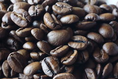 Roasted coffee close-up. A pile of roasted coffee. Macro photo of a grains coffea arabica Royalty Free Stock Photo