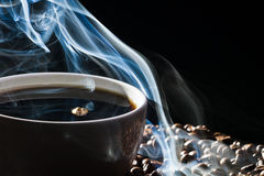 Roasted coffee and cup Stock Images