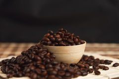 Roasted coffee. Cup full of coffee beans stock photo