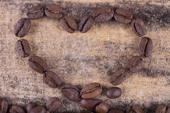 Roasted coffee grains in the form of heart Stock Photo