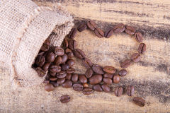 Roasted coffee grains in the form of heart Stock Images