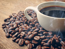 Roasted coffee  on grunge wooden background Stock Photos