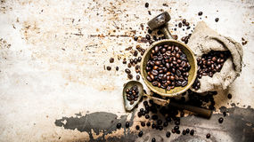 Free Roasted Coffee In A Mortar With Pestle And The Bag. Stock Photo - 67696980