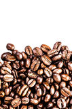 Roasted Coffee Macro Background. Arabica Coffee Beans background. Texture isolated on white background frame with copy space for text Royalty Free Stock Photography