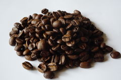 Roasted coffee. A pile of roasted coffee. Grains of a coffea arabica Stock Photo