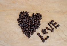 Roasted coffee shaped into heart and spelling the word love - image stock photos