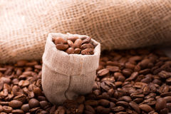 Roasted coffee in small bag Royalty Free Stock Photos