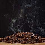 Roasted coffee with smoke Royalty Free Stock Photography