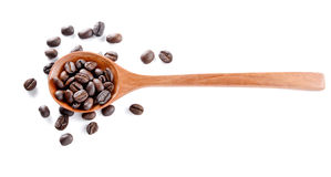 Roasted coffee,woden spoon on white background. Royalty Free Stock Photo