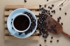 Roasted coffee. On a wooden floor Stock Photos