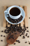 Roasted coffee. On a wooden floor Royalty Free Stock Photos