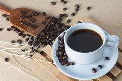 Roasted coffee. On a wooden floor Stock Photo
