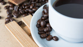 Roasted coffee. On a wooden floor Royalty Free Stock Images