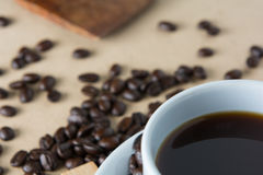 Roasted coffee. On a wooden floor Stock Photography