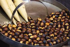 Roasted colorful chestnuts in street cafe Stock Images