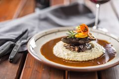 Roasted or confit beef steak mashes potatoes wegetable and sauce Royalty Free Stock Image