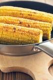 Roasted corn on pan Royalty Free Stock Image