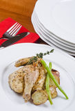 Roasted Cornish Game Hen Served and Potatoes Stock Photo