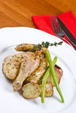 Roasted Cornish Game Hen Served and Potatoes Royalty Free Stock Photo