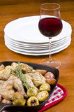Roasted Cornish Game Hen Served with Red Wine Stock Photos