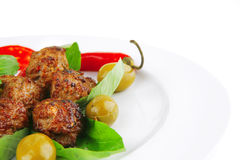 Roasted cutlets on basil Royalty Free Stock Photo