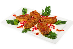 Roasted cutlets on a plate Royalty Free Stock Image
