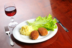 Roasted cutlets  and  wine Royalty Free Stock Images